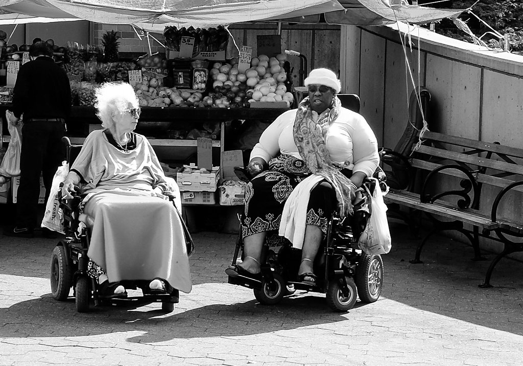Two ladies having conversations in wheelchairs