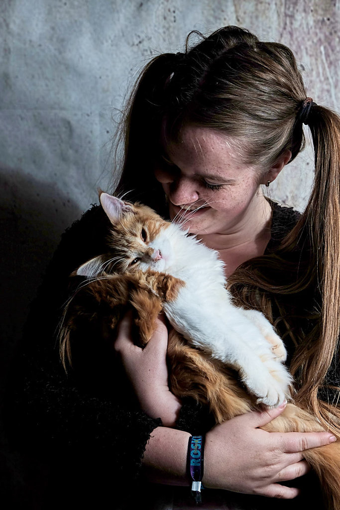 girl-with-pig-tails-and-her-maine-coon-cat.jpg