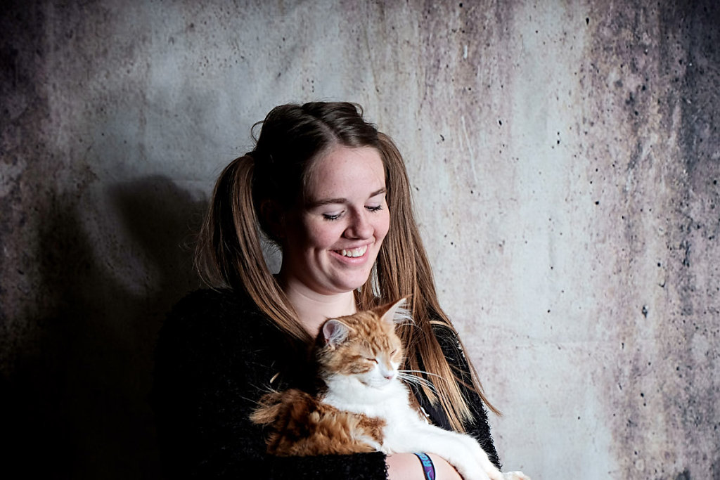 girl-with-pigtails-holding-a-cat.jpg
