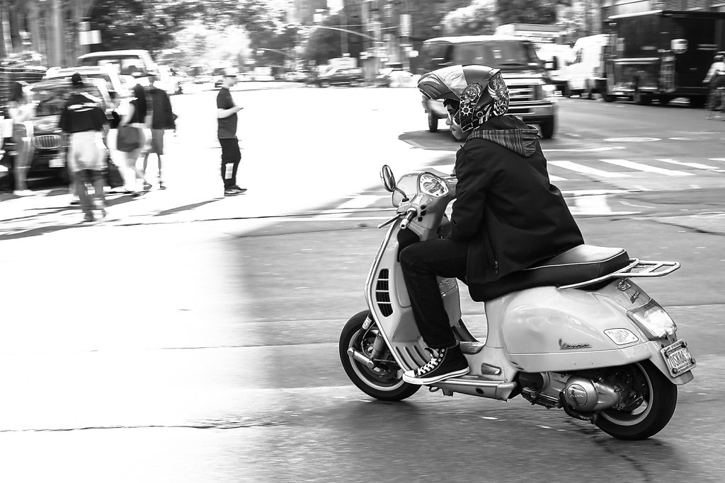 man-driving-a-moped.jpg