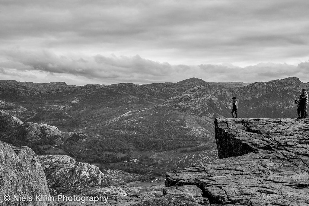 people on the edge of pulpit rock